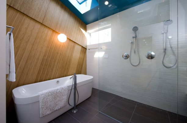 a blue ceiling and a bossy gray floor make a stunning contemporary bathroom