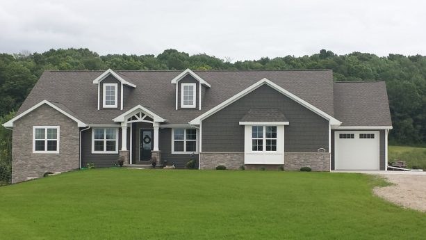 a combination of shadow vinyl siding and stone is perfect for a craftsman style ranch house