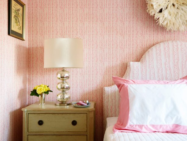 a pink wallpaper and a lovely savannah stripe headboard can easily beautify a girl's bedroom