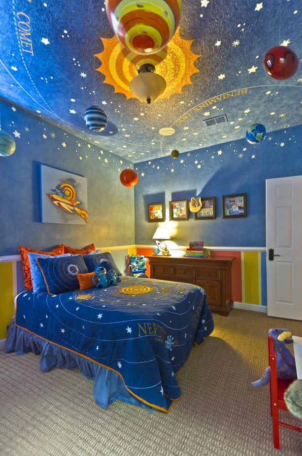 a stellar contemporary bedroom that lets you explore the solar system centering on a yellow and orange sun in the middle of a sky of blue walls and ceiling