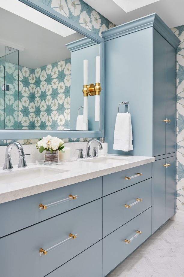 blue cabinets and a gray floor for a sleek mid-sized master bathroom