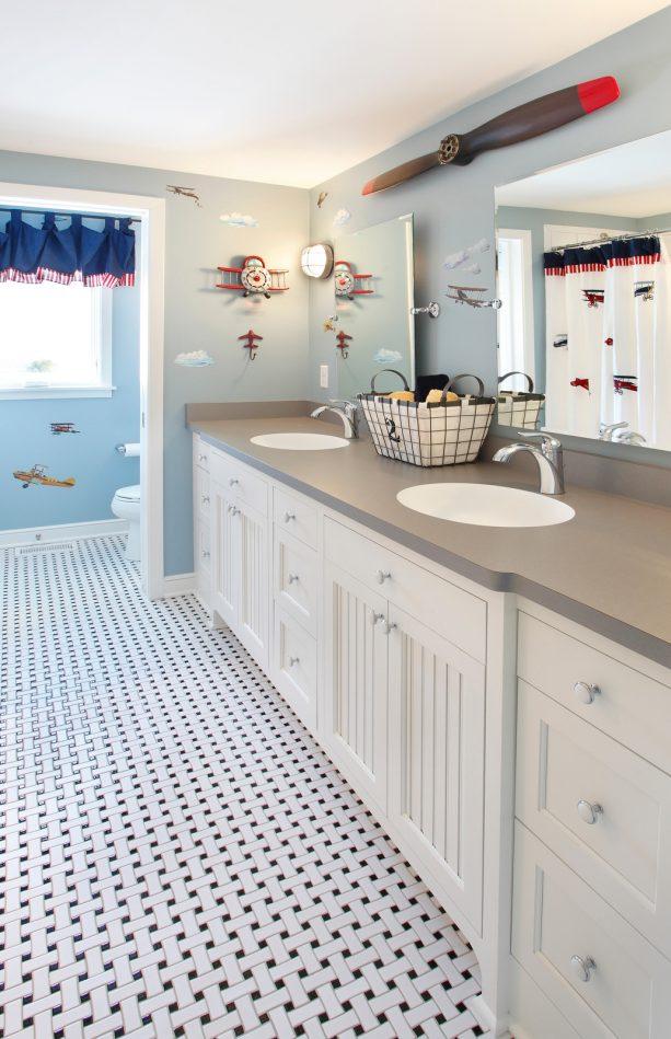 languid blue walls and a gray countertop make a cheerfully bright kids' bathroom