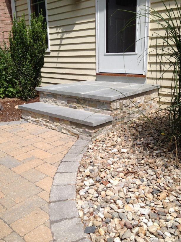 concrete and stone veneer covering go hand in hand with bluestone