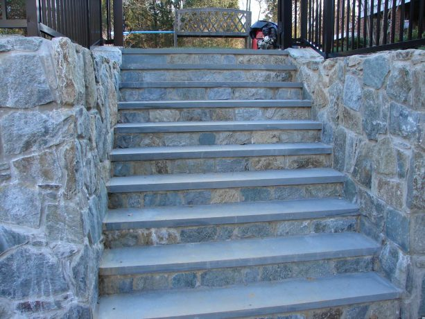 create a cohesive look by using stone veneer on the risers on your stairs