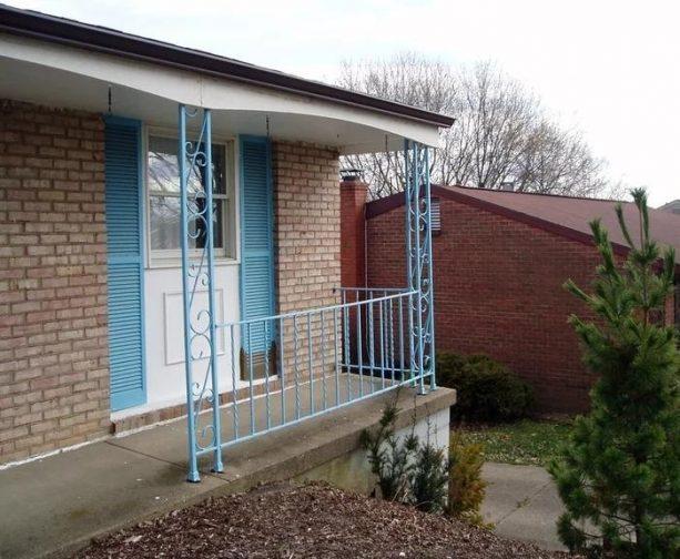 light blue wrought iron columns create a beautiful pop at a front porch