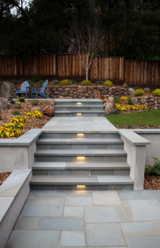 sleek stone veneer covering gives concrete steps a clean and fabulous look