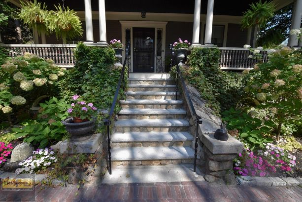 thin stone veneer stair covering for a beautiful and welcoming house
